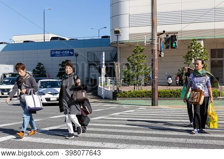 Beppu, Oita, Kyushu, Japan, November 11, 2017: A Group Of Elderly Women Cross A Street At A Pedestri