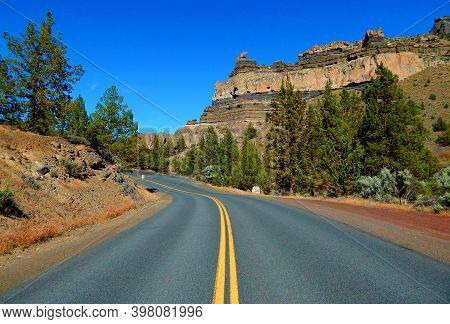 Road By The Rocks - A View Of Steamboat Rock Along Jordan Road In The Cove Palisades State Park - Ne
