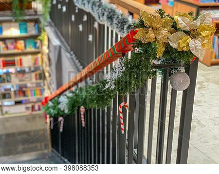 Stairs Handrail With Snowy Garland And Baubles For Christmas Decoration