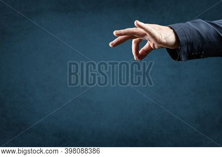 Template Image. Man's Hand Holds An Empty Space With Two Fingers. Manipulation Concept. Businessman