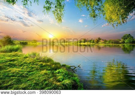 Sunset On A Calm River In Summer