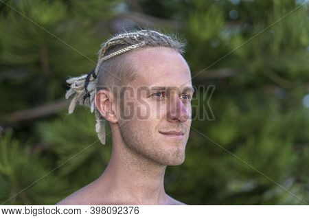 Portrait Of A Young Guy With Dreadlocks On His Head In Nature. Happy Handsome Man With Dreadlocks On