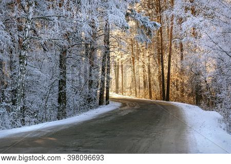 Amazing Winter View With Asphalt Road Through A Snowy Forest With Trees Covered In Hoarfrost, Snowdr
