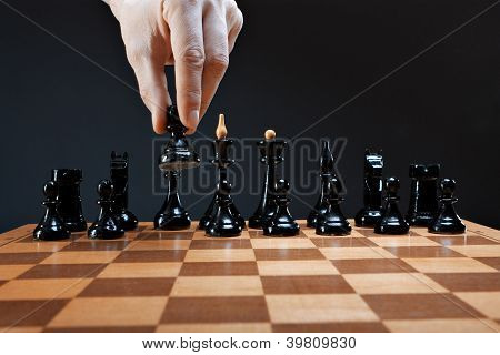 hand moves chess pawn
