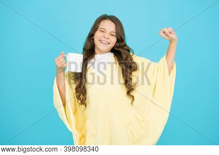 Wellbeing Concept. Little Girl With Long Hair. Feeling Comfy. Adorable Child On Turquoise Background