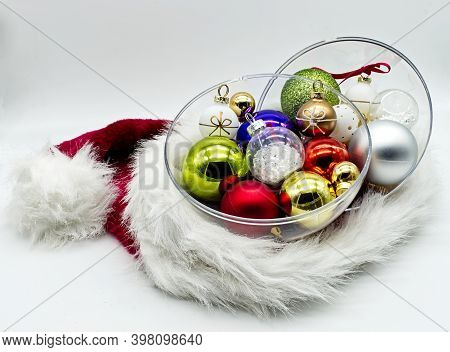 Christmas Balls Tree Inside A Santa Christmas Hat Isolated On White. Traditional Christmas Ornament