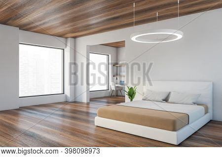 Open Space Bedroom With Wooden And White Design, Big Bed With Linens And Plant, Side View. Workplace