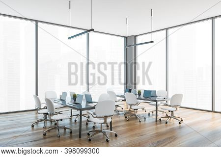 Grey And Wooden Office Room With White Chairs And Tables With Laptops, Side View, Near Large Window