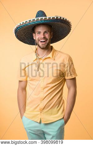 Mexican Holiday Concept. Man Cheerful Face Festive Mood Posing In Sombrero Hat Yellow Background. Gu