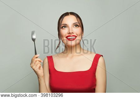 Happy Woman With Empty Fork On White Background. Food Temptation.
