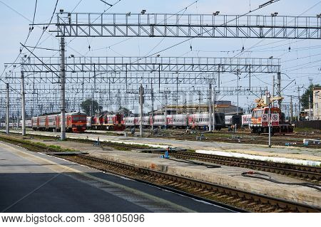 Perm, Russia - August 07, 2020: Intercity And Regional Passenger Trains On The Tracks Near The Platf