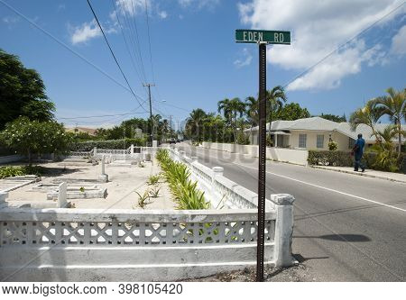 The View Of George Town Eden Road With A Street Sign Pole And A Little Cemetery Very Close To The Ro