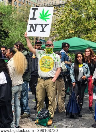 New York, Ny/usa - May 4: A Person Holds A Sign That Says