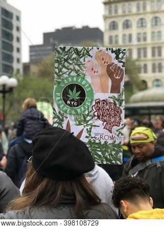 New York, Ny/usa - May 4: Someone Holds A Sign Promoting The New York City Cannabis Parade And Rally