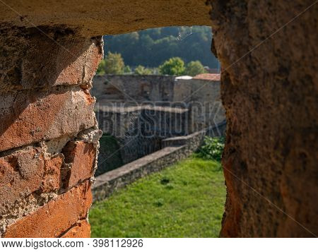 A Cobweb In The Embrasure Of An Old Fortress Wall