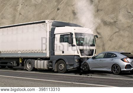 Speed And Carelessness On The Street. Accident Between A Truck And A Car