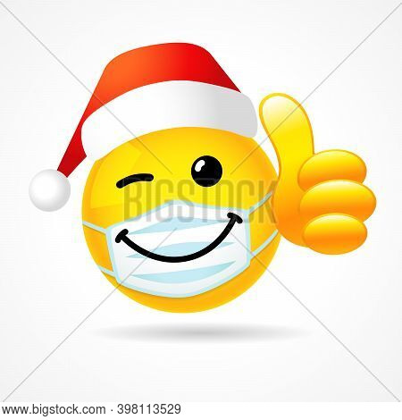 Winking Smile In Medical Mask Showing Thumb Up With Santa Hat. Emoji Face With White Guard Mouth Mas