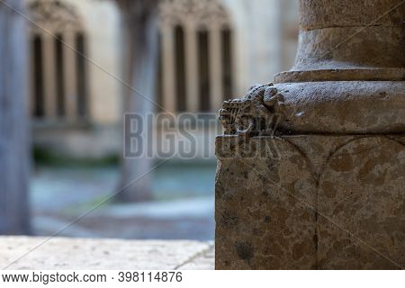 Small Figure On The Basis Of A Column Of The Cloister At The Cathedral Of Ciudad Rodrigo. Spain.