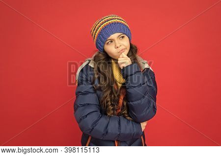 Winter Dreaming. Thoughtful Child In Warm Winter Clothes. Seasonal Fashion For Kids. Small Beauty Re