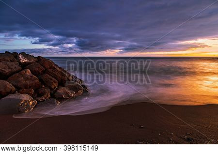 Volcanic stones  beach in sunset time  in Tenerife, Canary Islands, Spain