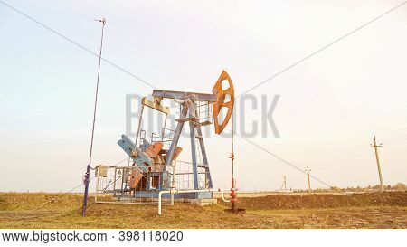 Oil Drilling Derricks Oilfield. Crude Oil Production From The Ground, Sunlight
