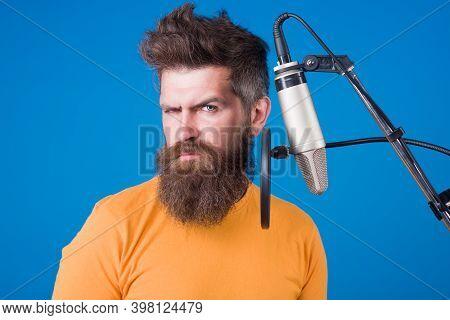 Bearded Man Sing In Microphone. Karaoke. Man Singing With Microphone. Singing In Studio. Microphone.