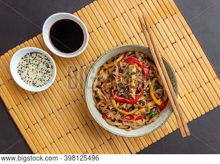 Noodles With Pork, Pepper And Soy Sauce. Asian Food. Wok.