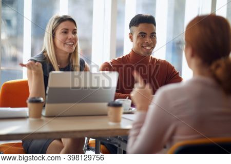 A young female applicant having an interview for a job with a company commission in a pleasant atmosphere. People, job, company, business concept.