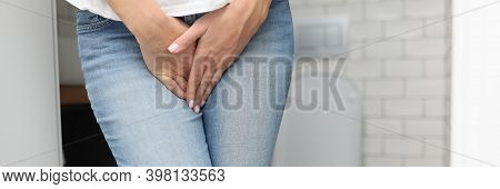 Female Hands Between Legs In Jeans Close-up. Diagnosis And Treatment Of Sexually Transmitted Disease