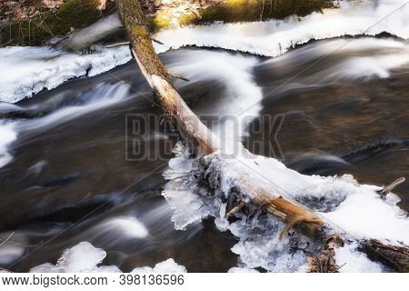 A Flowing Stream Covered In Ice And Snow In Deans Ravine In Falls Village Connecticut On Winter Day.
