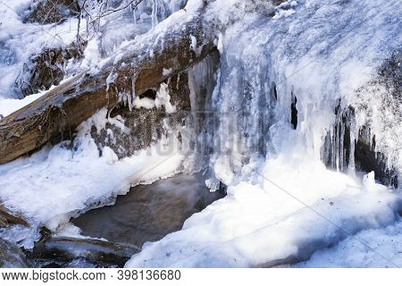 The Frozen Base Of Deans Ravine Waterfall In Falls Village On The Mohawk Trail In Connecticut On A W