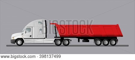 Road Train With An American Tractor And A 3-axle Dump Semi-trailer. Truck For Delivering Goods To A