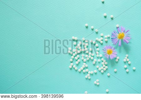 Homeopathic Globules On A Blue Background. Homeopathy Medicine Alternative Herbs, Healthcare And Pil