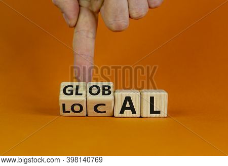 Local Or Global Symbol. Hand Turns Cubes And Changes The Word 'local' To 'global'. Beautiful Orange