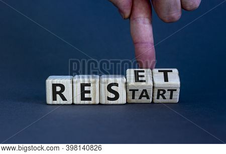 Reset And Restart Symbol. Hand Turns Cubes And Changes The Word 'restart' To 'reset'. Beautiful Grey