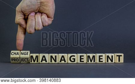 Change Or Project Management Symbol. Hand Turns Cubes And Changes The Words 'project Management' To