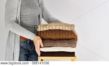 Autumn Winter Season Knitwear. A Stack Of Warm Knitted Sweaters With Different Knitting Patterns On