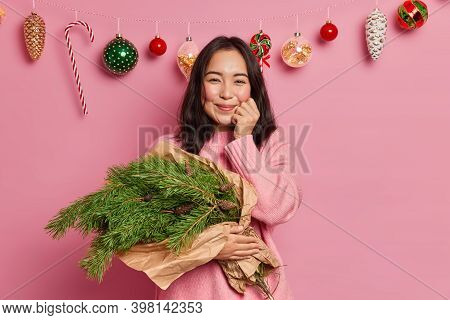 Adorable Ethnic Millennial Girl Has Dark Hair Has Pleased Face Expression Smiles Pleasantly Dreans A