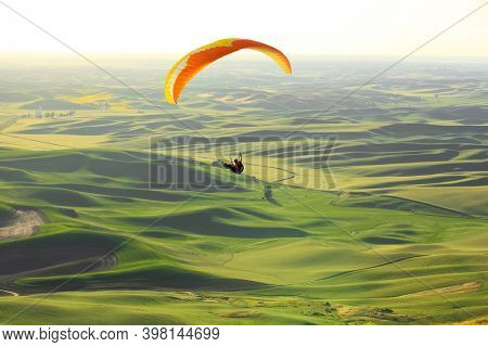 Glider flying over rolling hills of Palouse ,Washington state