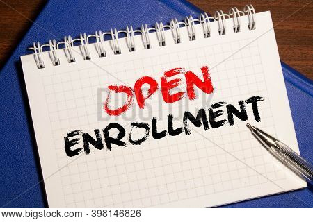 Doctors Desk With Notebook And Text - Open Enrollment.