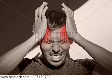 Man Suffering From Painful Migraine Or Strong Tension Headache. Cluster Headache, Stress. Hands On H