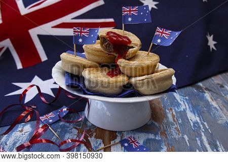 A Plate Of Traditional Meat Pies With Tomato Sauce On An Australian Flag For An Australia Day Party