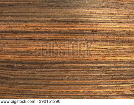 Natural Yellow Royal Ebony Wood Texture Background. Veneer Surface For Interior And Exterior Manufac