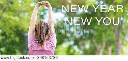 New Year New You With Young Woman Stretching Muscle In The Park Outside, Runner Warm Up Ready For Ru