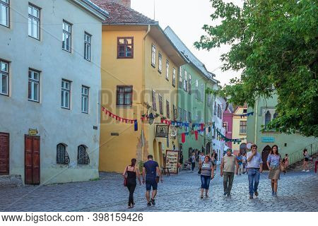 Sighisoara, Romania - August, 2019: Summer Streetlife In Center Of Sighisoara In Romania. This Town