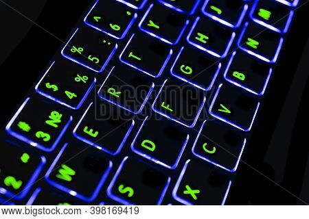 Close Up View Of A Modern Laptop Computer Keyboard Key With Blue Buttonss. Pc Computer Keyboard Clos