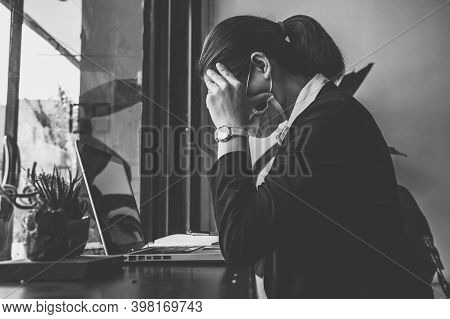 Businesswomanman Having Headache And Tired From Work During Covid-19 Pandemic. Conceptual Of Busines