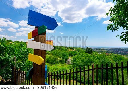 Wooden Colorful Arrow Shape Signs, Points The Way To The Different Destinations, Crossroad Signpost.