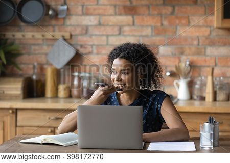 Smiling Young Mixed Race Woman Dictating Audio Message.