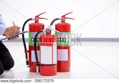 Fire Engineering Checking Pressure Gauge Indicator Chemical Liquid Level Of Fire Extinguishers Tank